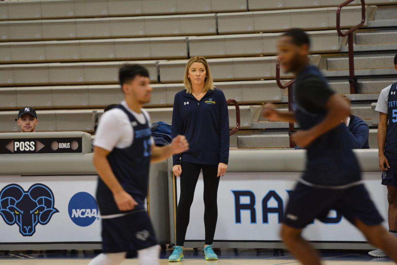 Assistant coach Stephanie Carideo supervises practice as the Rams prep for the home opener versus Saint Anselm.