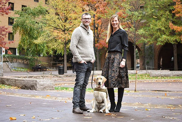 eashes of Valor cofounders Jason Haag and Danique Masingill presented at Jefferson with Maggie, a 9-month-old Labrador in training