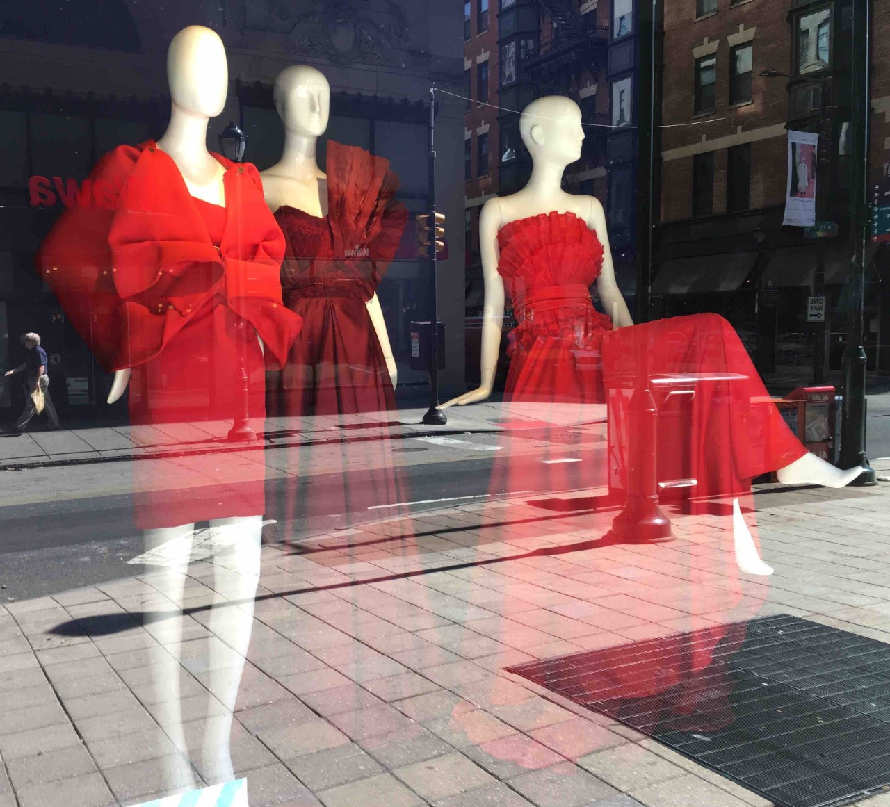 Red dresses on display at Macy's window