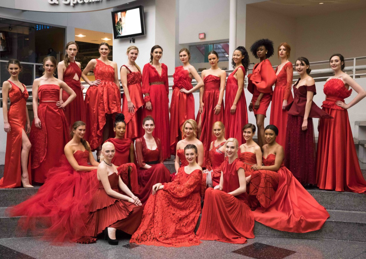 Models wearing red dresses