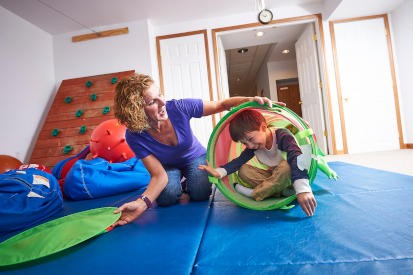 Roseanne Schaaf, PhD, using a sensory-integration approach to work with children