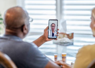 Older couple using telehealth on a smartphone